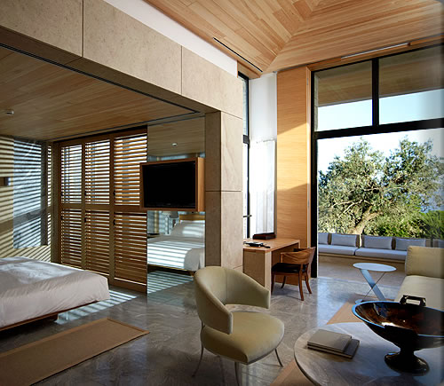Amanzoe pool pavilion bedroom and living area